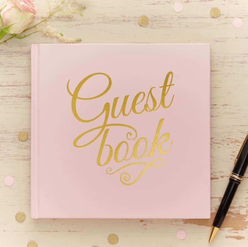 Gästebuch in rosa mit Goldschrift