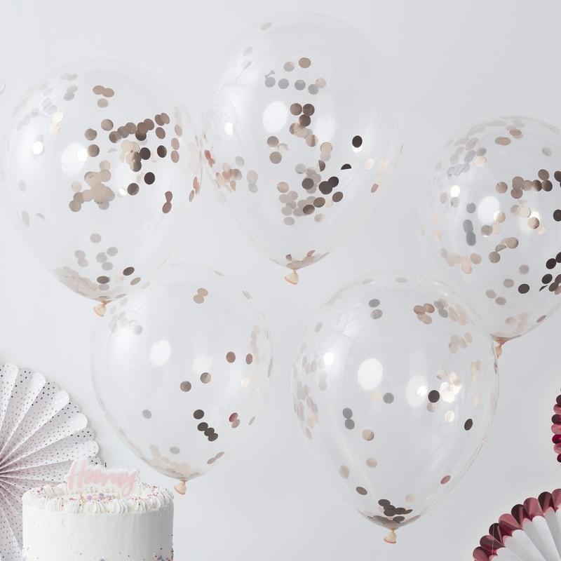 Luftballons mit rosegoldenem Konfetti gefüllt